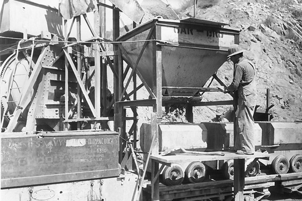 black and white capture of old mining equipment digging waterways in the 40s