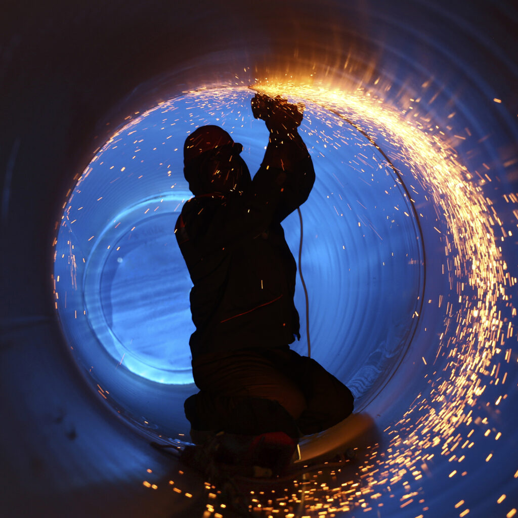 working welding inside a pipline with sparks flying