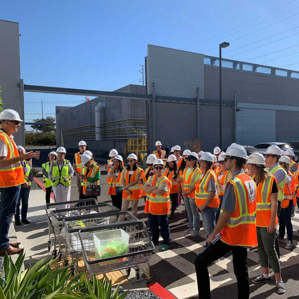 tour group in hard hats about to take a facility tour
