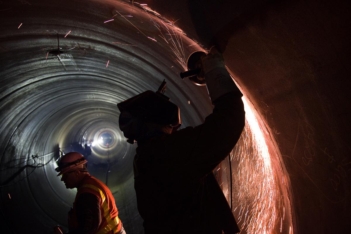 worker repairing a pipeline