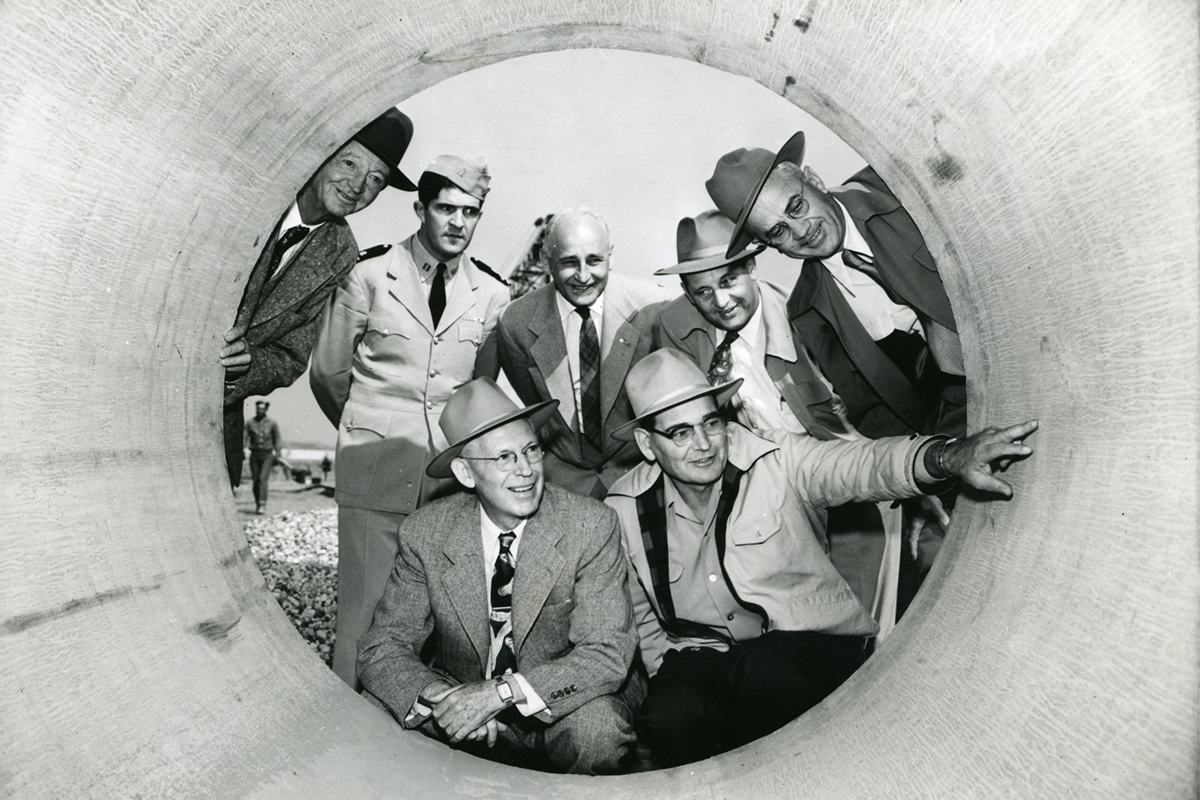 people posing for a picture in the first pipe